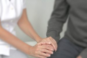 Therapist offering comfort to patient